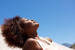 Young african woman relaxing outdoors Stock Photo