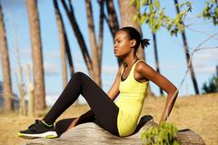Young african woman resting outdoors after running workout Stock Images