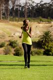 Young african woman running outdoors Stock Photography