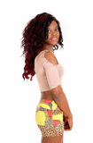 Young African woman in skirt. Stock Photo