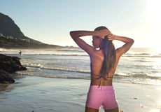 Young african woman standing at the beach in bikini Stock Images