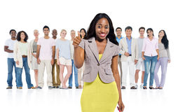 Young african woman standing out from crowd stock photos