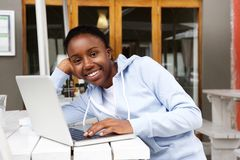 Young african woman talking with friends online Royalty Free Stock Photos