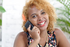 Young African woman talking on the phone Stock Photos