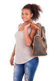 Young African woman travelling with her bag - isolated over whit Stock Photo