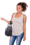 Young African woman travelling with her bag - isolated over whit Stock Photography