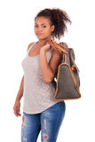 Young African woman travelling with her bag - isolated over whit Royalty Free Stock Photography
