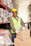 Young African worker as a packager stock photo
