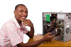 Young african worker in service repairing a desktop stock photos