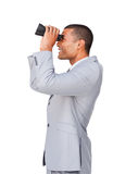 Young afro-american businessman using binoculars Stock Photos