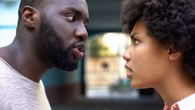 Young afro-american couple arguing outdoor, misunderstanding, jealous spouse. Stock photo royalty free stock photos
