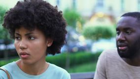 Young afro-american couple arguing outdoors, lies in relationships, breakup. Stock footage stock footage