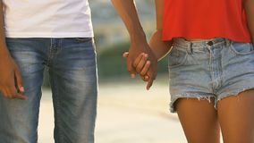 Young Afro-American couple holding hands outdoor, romantic date, slow-motion stock video