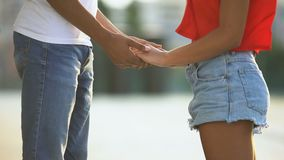 Young afro-american couple holding hands, shy feelings in adolescent, sympathy. Stock footage stock video footage