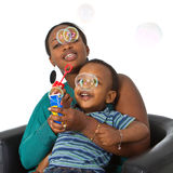 Young afro american family with bubbles stock photo