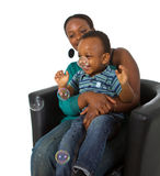 Young afro american family with bubbles Royalty Free Stock Photography
