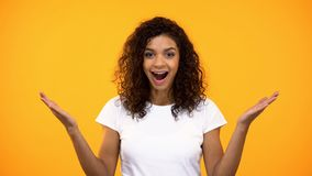 Young afro-american female showing wow gesture on camera, good news, surprise. Stock photo stock photos