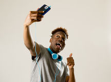Young afro american man smiling happy taking selfie self portrait picture with mobile phone Stock Photo