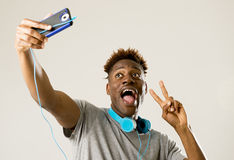 Young afro american man smiling happy taking selfie self portrait picture with mobile phone Stock Photography