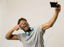 Young afro american man smiling happy taking selfie self portrait picture with mobile phone Royalty Free Stock Image