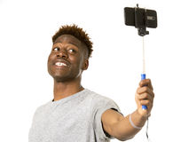 Young afro american man smiling happy taking selfie self portrait picture with mobile phone Stock Photos