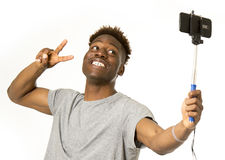 Young afro american man smiling happy taking selfie self portrait picture with mobile phone Royalty Free Stock Photo