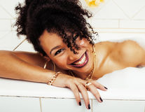 Young Afro-american Teen Girl Laying In Bath With Foam, Wearing Stock Image