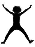 Young afro american woman silhouette happy jumping Royalty Free Stock Images