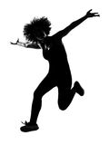 Young afro american woman silhouette happy jumping Royalty Free Stock Photos