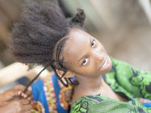 Young Afro beauty being breaded Stock Image