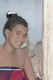 Young Afro beauty at the door of her house Stock Images
