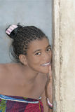 Young Afro beauty at the door of her house Royalty Free Stock Photos