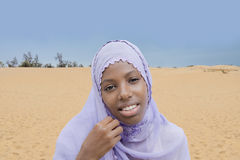 Young Afro beauty wearing an embroidered veil Stock Photo