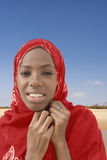 Young Afro beauty wearing a red headscarf Stock Photo