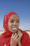 Young Afro beauty wearing a red headscarf Stock Photos