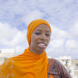Young Afro beauty wearing a traditional headscarf in the street Royalty Free Stock Photos