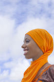 Young Afro beauty wearing a traditional headscarf in the street Royalty Free Stock Photo