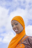 Young Afro beauty wearing a traditional headscarf in the street Stock Images