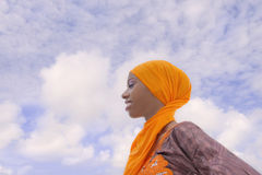 Young Afro beauty wearing a traditional headscarf in the street Stock Image