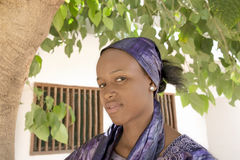 Young Afro beauty wearing a violet headscarf Royalty Free Stock Image