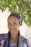 Young Afro beauty wearing a violet headscarf Stock Photos
