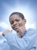 Young Afro boy, sunshine and sunny day Royalty Free Stock Photography