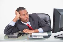 Young Afro businessman resting at desk Royalty Free Stock Images