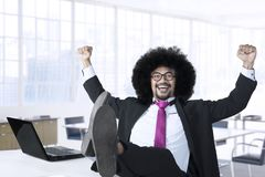 Afro manager celebrating his success Stock Photo