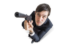 Young agent or murderer is aiming with gun. View from top. Isolated on white background Royalty Free Stock Images