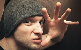 Young aggressive Caucasian man gesture Stock Photography