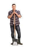 Young agricultural worker posing with a shovel Royalty Free Stock Photo