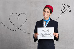 Flight assistant wishing Bon Voyage Stock Images