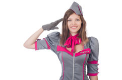 Young airhostess saluting. Isolated on white Stock Photos