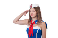 Young airhostess saluting Royalty Free Stock Photo